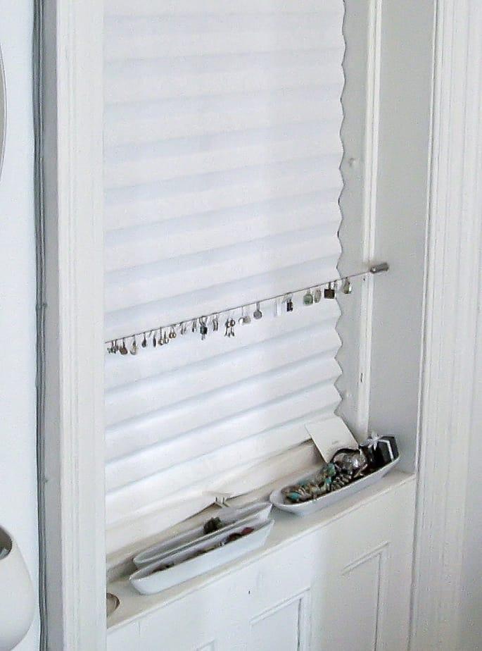 Earring holder using window frame